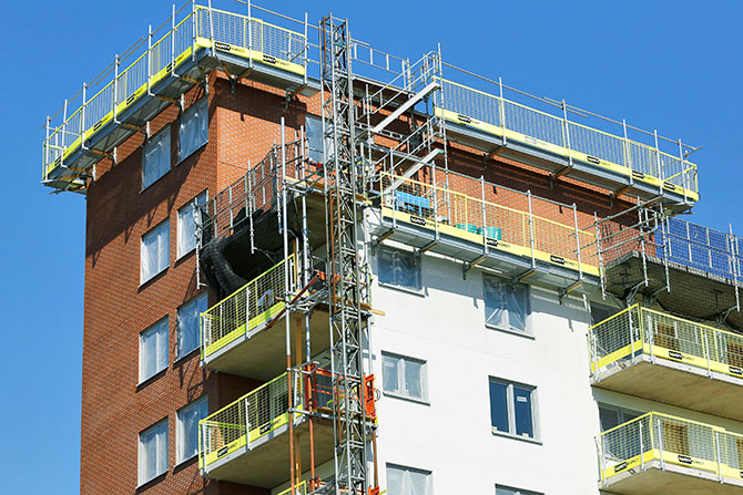 Building hoist, stair tower and edge protection